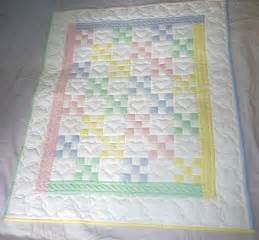 amish infant quilt in a traditional nine patch pattern