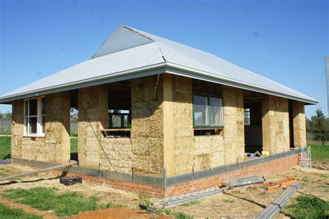 the pros and cons of straw bale wall in green building