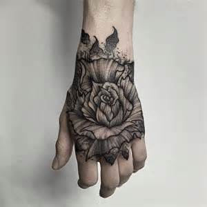 flower hand tattoo simple black flower tattoo on hand