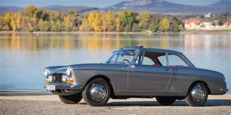 peugeot 404 coupe the peugeot 404 coup 233 is a french touring car with a hint
