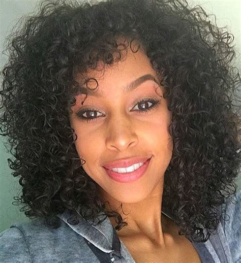 Hairstyles For Tight Curly Hair by Style Your Curls In 50 Ways