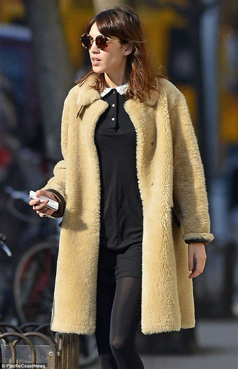 alexa chung is in fashion as she shows off her cosy teddy