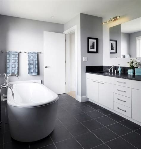 bathrooms with grey walls bathroom with dark grey floor light grey walls white