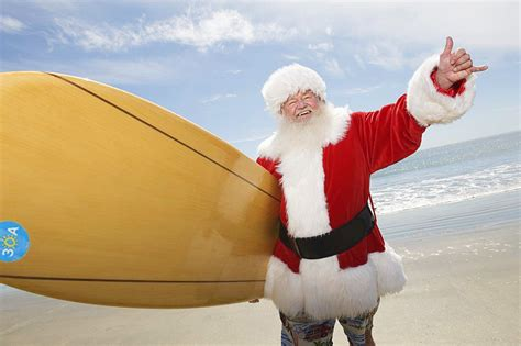 santa on surfboard merry 30a