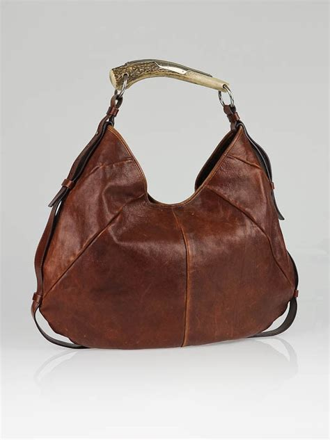 Simpsons Yves Laurent Mombasa Purse by Yves Laurent Brown Buffalo Leather Mombasa Horn Bag