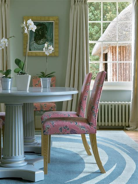 eclectic dining room  pink patterned chairs hgtv