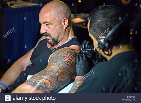 tattoo convention nyc hilton man getting a large arm tattoo at the new york tattoo