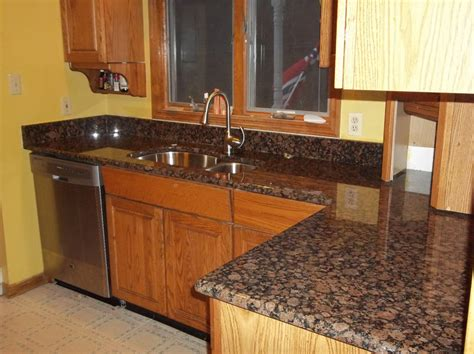 Brown Kitchen Cabinets With Granite Countertops by Baltic Brown Granite Makes Your Kitchen Countertop Looks