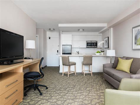 bedroom and living room in one space one bedroom hotel suite with balcony chelsea hotel toronto