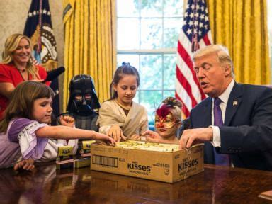 trump hosts white house reporters kids for oval office trump greets oval office trick or treaters i can t