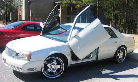Cadillac With Doors by In The Cadillac With Lamborghini Doors You Can See
