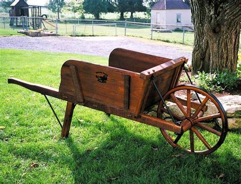 Rustic Wheelbarrow Planter by 25 Best Ideas About Wooden Wheelbarrow On