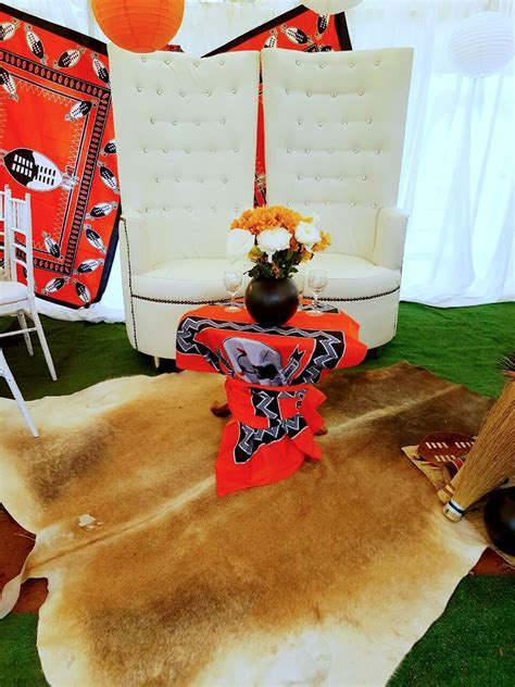 Orange and black traditional Swazi wedding decor   bride
