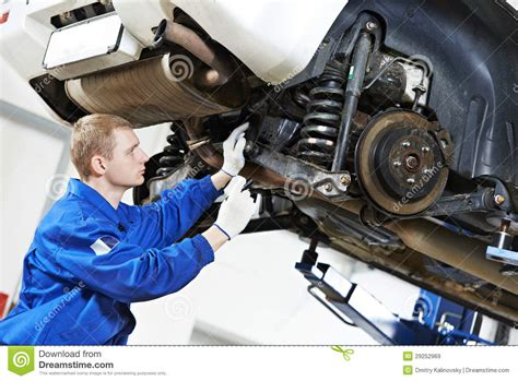 car suspension repair auto mechanic at car suspension repair work royalty free