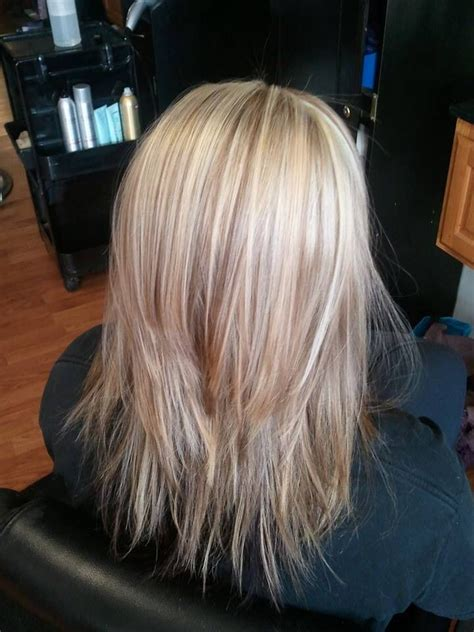 medium length hair style low lights medium length long layered hair cut with blonde