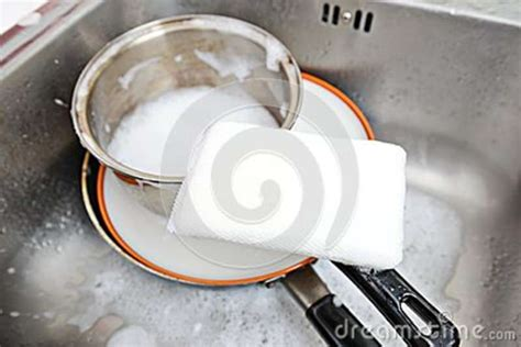 washing dishes in bathroom sink sponge royalty free stock photos image 35262768