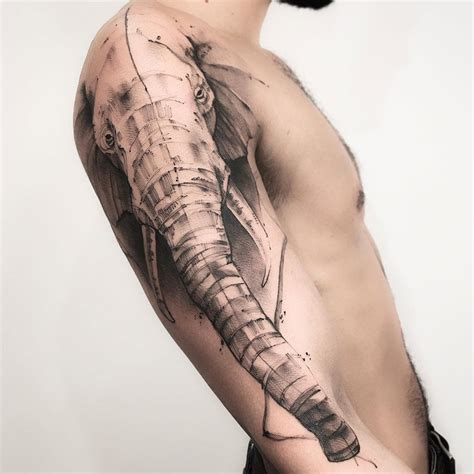 elephant done in a sketch style on guys arm best tattoo