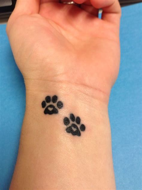 paw prints on wrist paw print tattoos 2013 i d get these with auburn