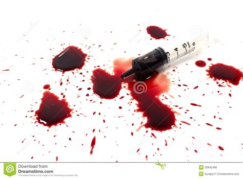 blood a drops of blood and a syringe royalty free stock image