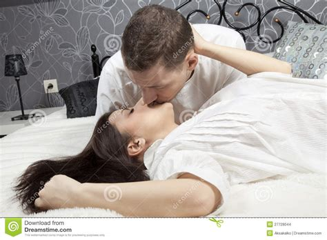how to be good in bed for men man and woman kissing in the bed stock images image