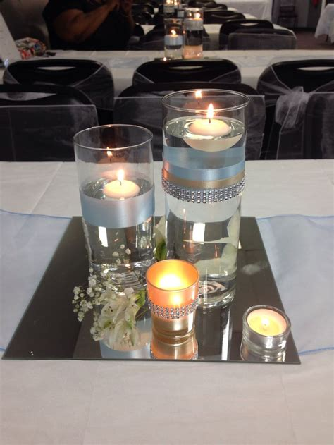 baby blue and chagne floating candle and mirrored