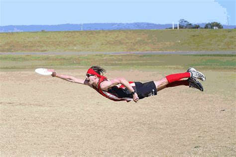 ultimate layout video ultimate frisbee player doing a layout photoshopbattles