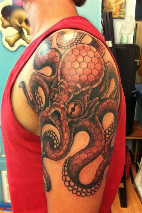 epic tattoos for men gorgeous octopus with small flower on shoulder