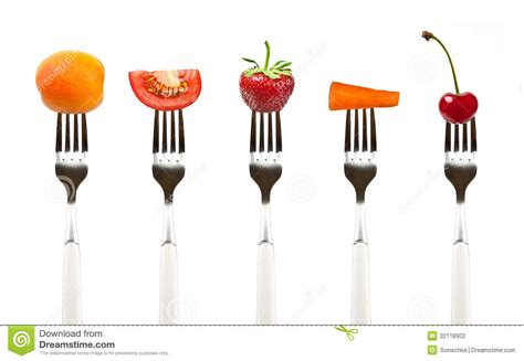 Mediterranean Vegan Kitchen - red fruits and vegetables on the collection of forks stock photography image 32118902