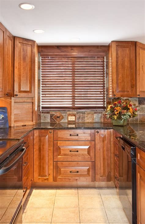 black rustic kitchen cabinets by kraftmaid kitchen rustic birch cabinets cabinets 855x1319 creative