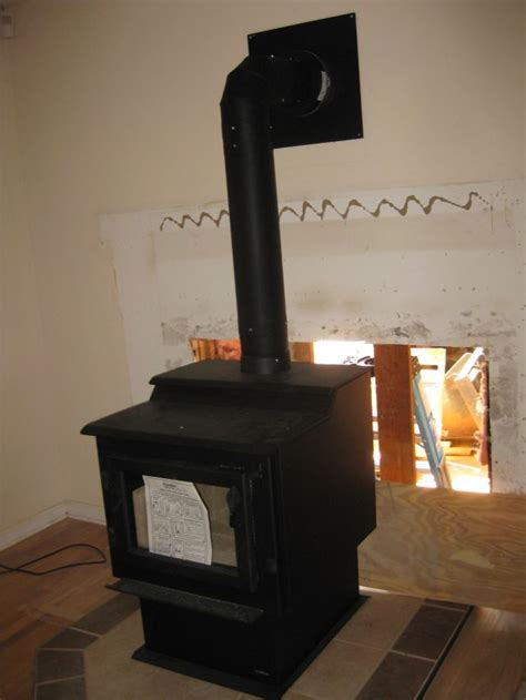 installing a wood stove and removal of the prefab fireplace