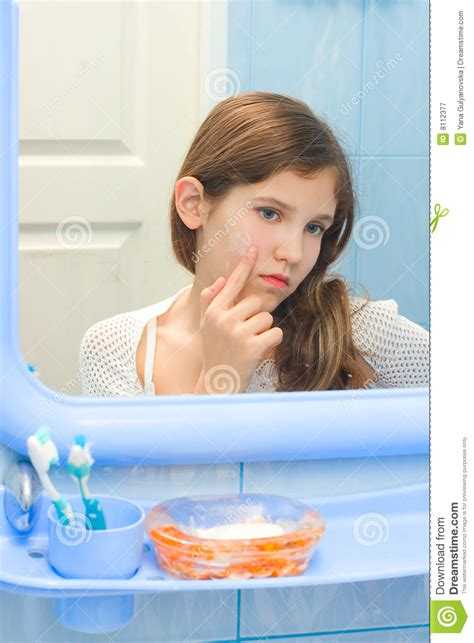 a girl using the bathroom teen girl in bathroom royalty free stock photography