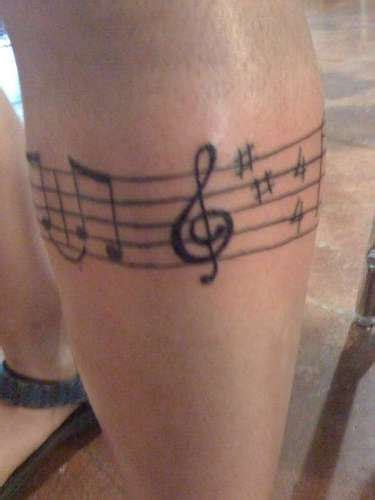 muscial band tattoo on leg