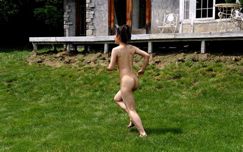 Cute Asian Girl Youzn Posing All Naked In The Yard