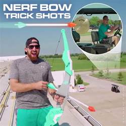 dude perfect s tyler toney bangs a gong with arrow fired