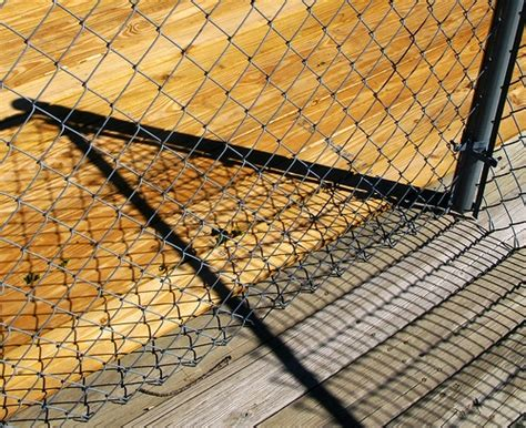 home design studio chain link wall d cor does chain link or wood make a cheaper fence homesteady