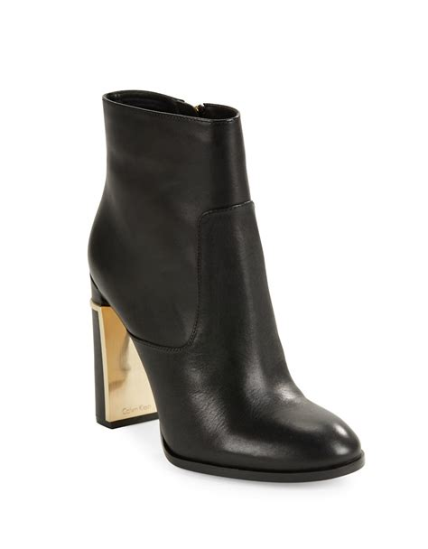 calvin klein karlia leather ankle boots in black lyst