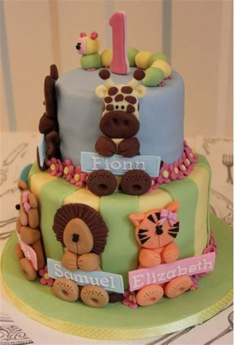animal two boy and one two tier birthday cake with animal theme for baby