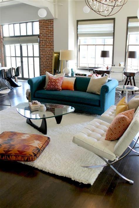 barcelona chairs noguchi coffee table  orange  teal color scheme