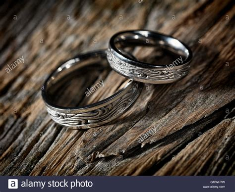 Wedding Ring Background Designs by Two White Gold Wedding Rings With Celtic Design On Rustic