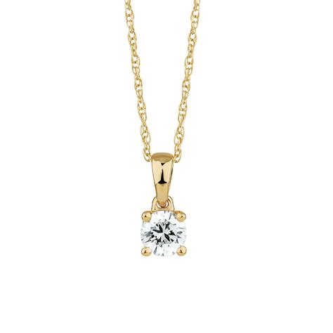 solitaire pendant with a 1 4 carat in 18kt yellow gold