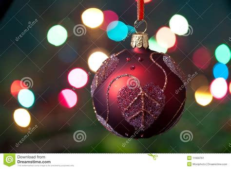 big christmas baubles and candles on dark stock image