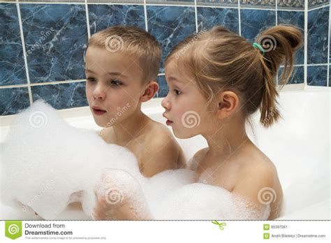girls in bathroom with boys brother and sister taking a bubble bath little boy and