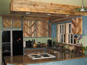 reclaimed kitchen cabinets reclaimed kitchen cabinets pallets used to reface the cabinet doors not a fan of it with the