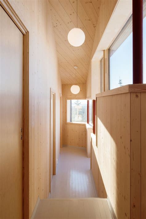 modern minimalism meets wooden warmth inside small winter dark and minimal contemporary norwegian cabins with