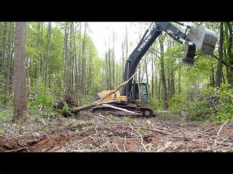 volvo ecbl excavator clearing land youtube