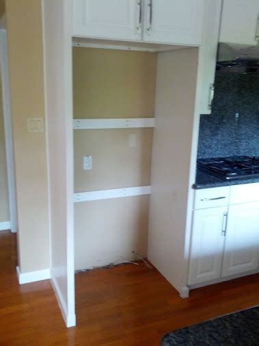 installing refrigerator cabinet side panels kitchens can i remove one side frame of the cabinets