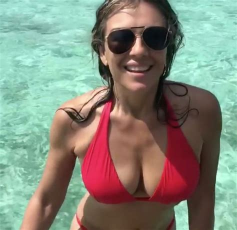 Liz Hurley Dumped For The Second Time This Year by Liz Hurley 52 Flaunts Impressive Cleavage Taut Tum And