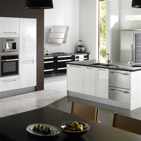 kitchens with white cabinets and black appliances give a vintage touch to the kitchen room decorating ideas