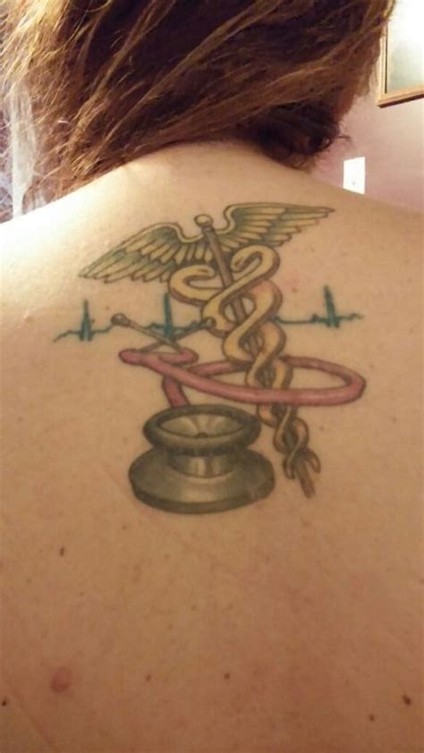 nurse with tattoos symbol stethoscope ekg tattoos