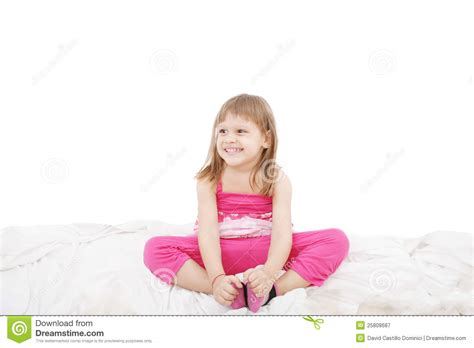 girl sitting on bed cute little girl sitting on the bed royalty free stock